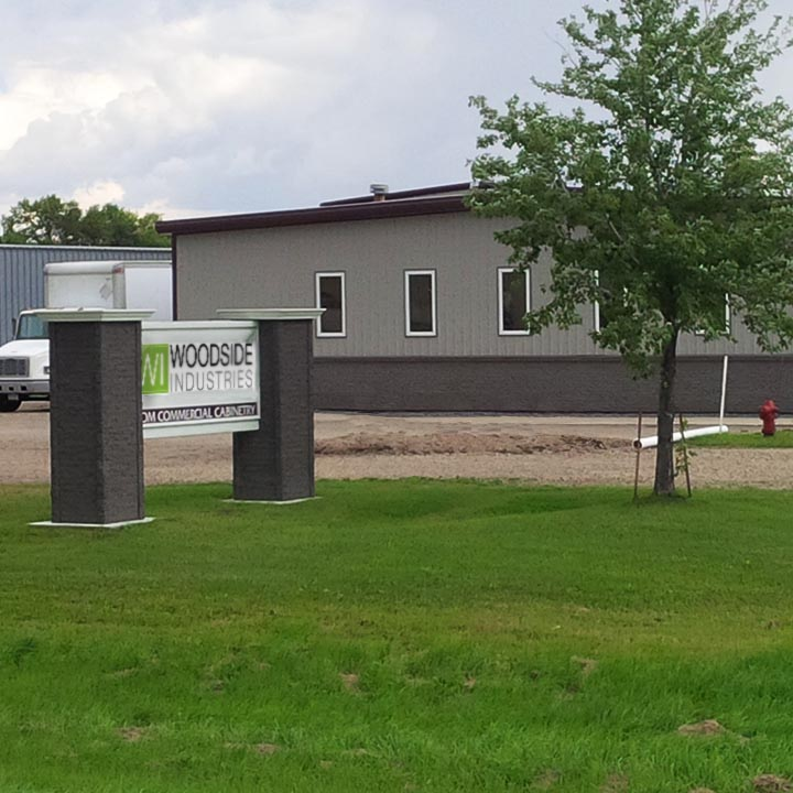 Woodside Industries sign and building