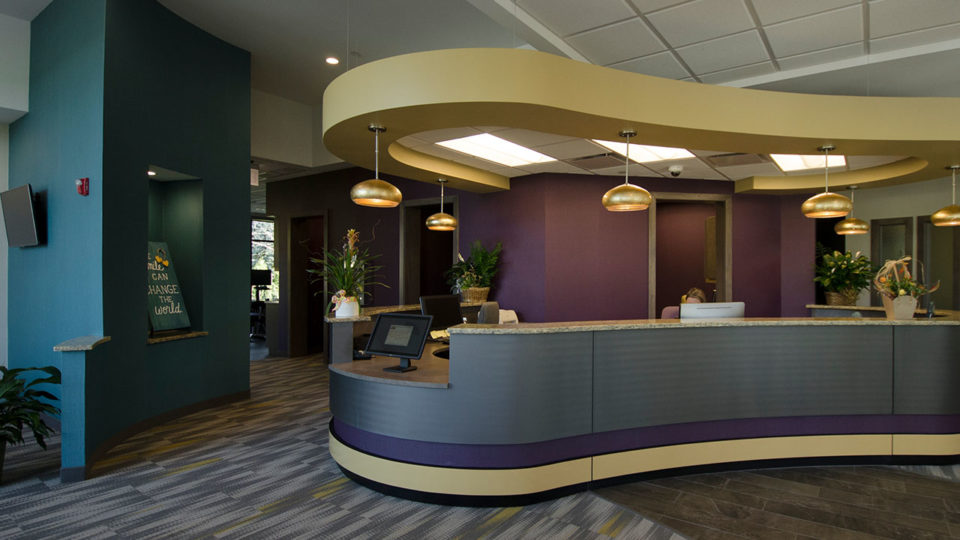 reception area with curved desk with multiple computer stations
