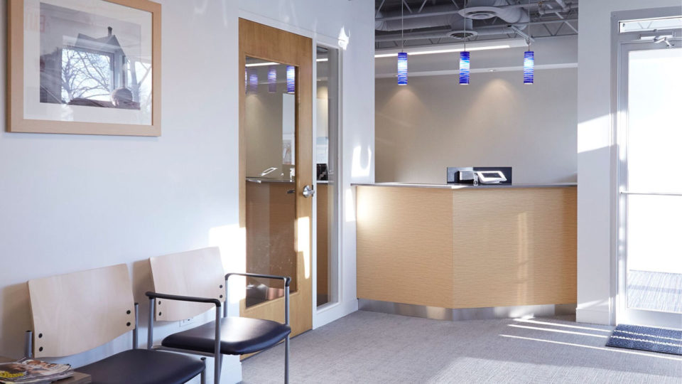 Light colored office space with a reception desk
